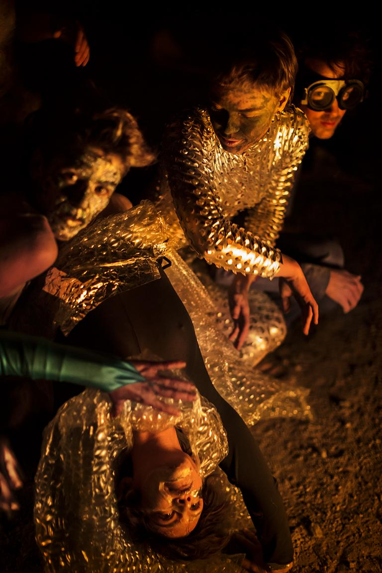 Photo documentation of dancers and performers in crafted costumes performing at a bonfore during the artist residency in Greece in February 2020 by portrait and event photographer Caroline Wimmer from Berlin.